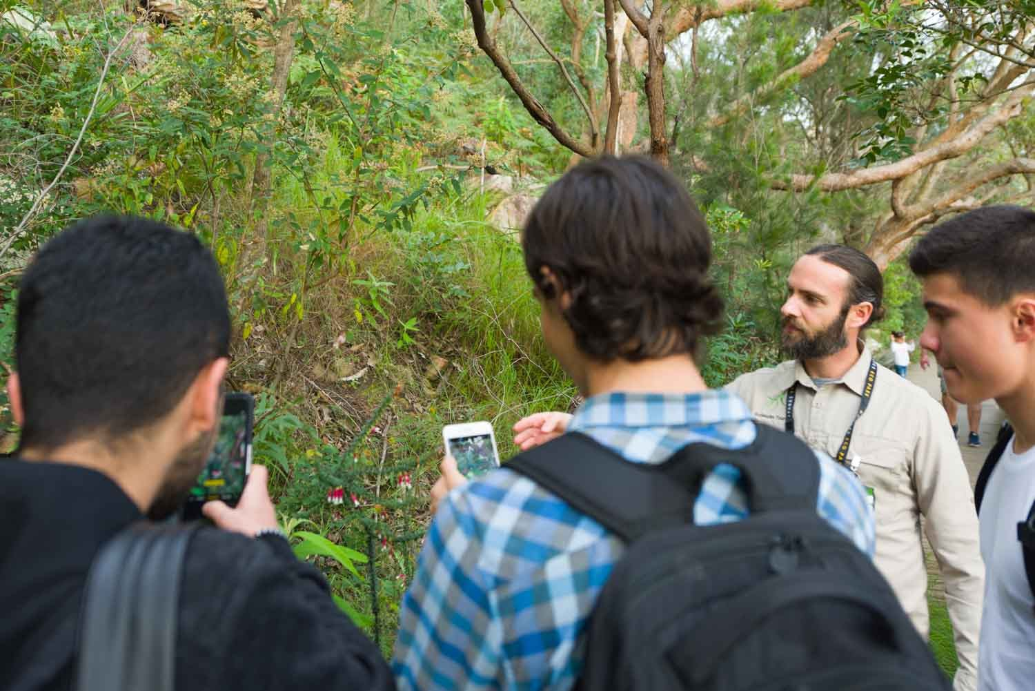 Guide showing visitors wild native flowers